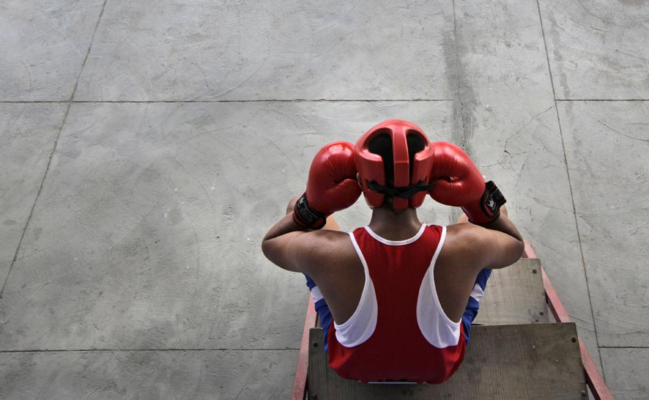 An amateur boxer takes a break during a practice session at the Bhiwani Boxing Club in Bhiwani, 122 kilometers west from New Delhi. The sleepy northern Indian town of Bhiwani is considered a mini Cuba, with dozens of boxers fighting it out hard in top national and international competitions. AP