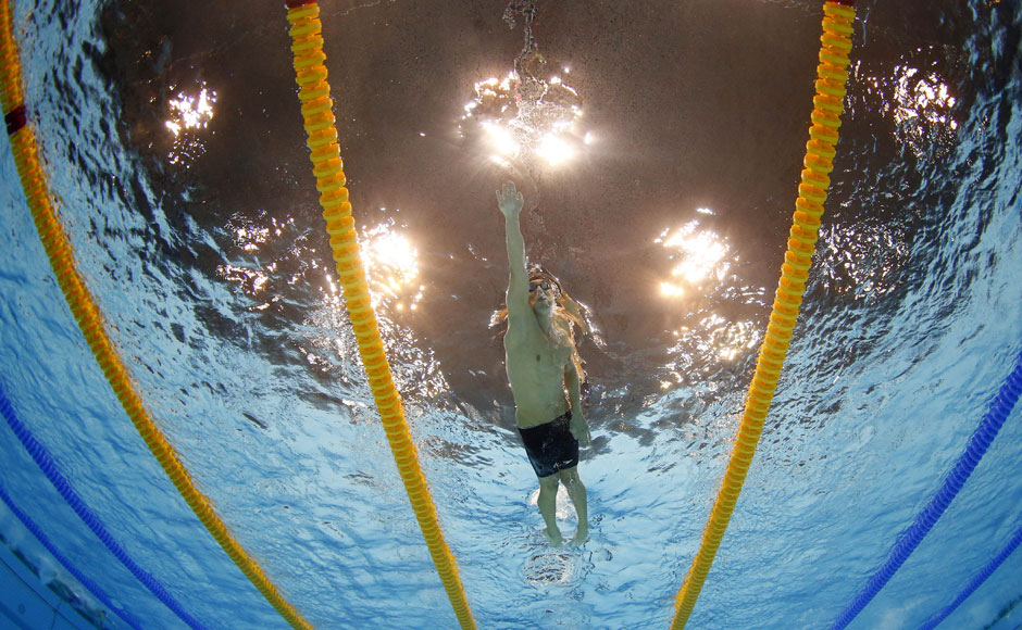 United States' Michael Phelps competes in the men's 4x200-meter freestyle relay swimming final at the Aquatics Centre in the Olympic Park .Mark J Terrill/AP