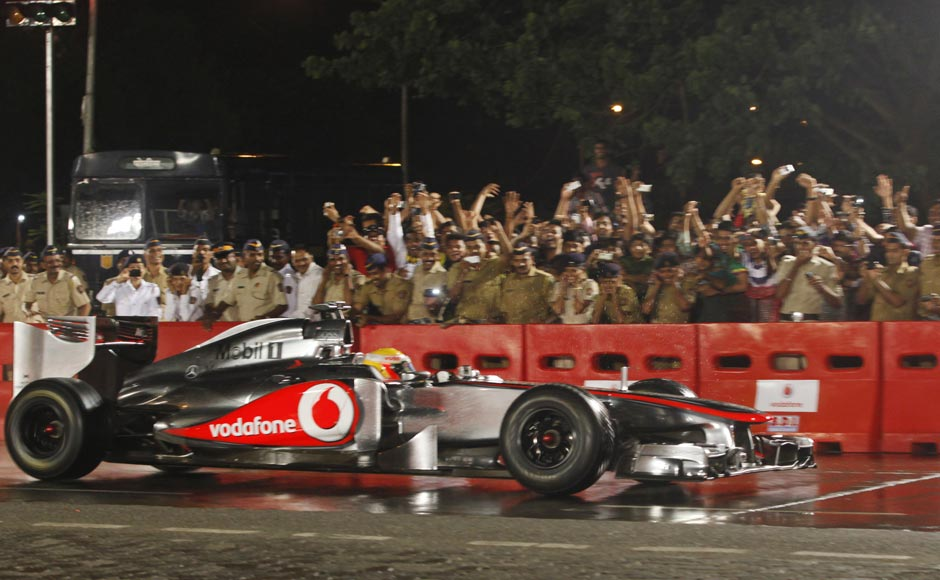 British Formula One driver Lewis Hamilton, currently racing for the McLaren team, drives an F1 car during Vodafone Speed Fest, a promotional event in Mumbai. Rajanish Kakade/AP