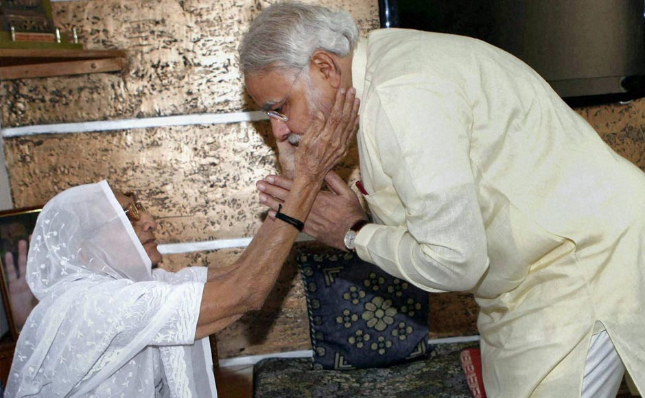 Gujarat Chief Minister Narendra Modi seeks blessing of his mother Heerabhen on his 62nd birthday in Gandhinagar. PTI