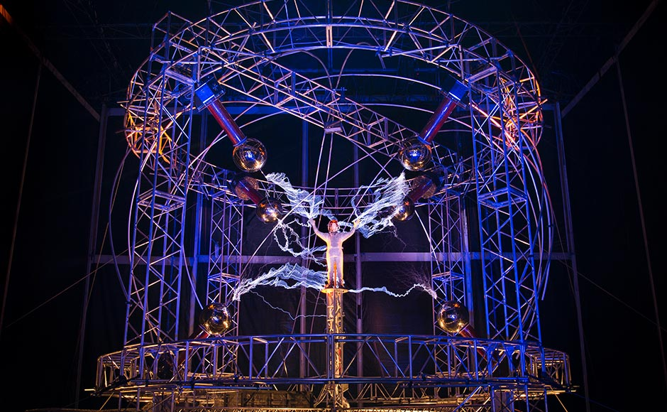 "Magician David Blaine stands inside an apparatus surrounded by a million volts of electric currents streamed by tesla coils during his 72-hour ""Electrified: 1 Million Volts Always On"" stunt on Pier 54, New York.  The stunt, sponsored by Intel, is the latest in a series of daredevil endeavours by the magician whose previous stunts included being encased in ice for over 60 hours in Times Square. John Minchillo/AP"