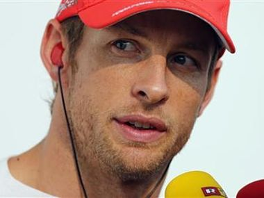McLaren Formula One driver Button talks to the media after retiring due to a collision with Sauber Formula One driver Kobayashi during the South Korean F1 Grand Prix at the Korea International Circuit in Yeongam. Reuters