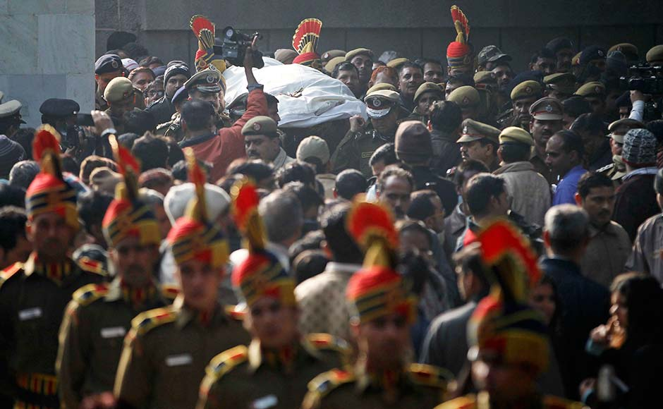 The body of constable Subhash Tomar is brought for cremation in New Delhi.  Tomar was injured in Sunday's clashes with people protesting against the brutal gang-rape of a woman on a moving bus died in hospital. Mustafa Quraishi/AP