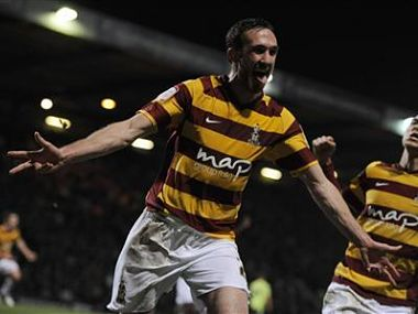 Bradford City's McArdle celebrates after scoring against Aston Villa during their English League Cup semi-final soccer match in Bradford. Reuters