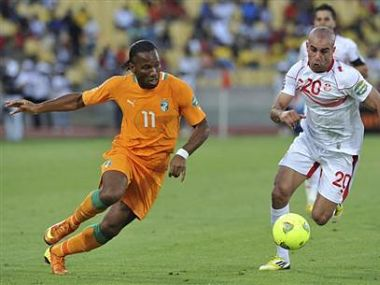 Ivory Coast's Drogba challenges Tunisia's Abdennour during their African Nations Cup Group D soccer match in Rustenburg. Reuters
