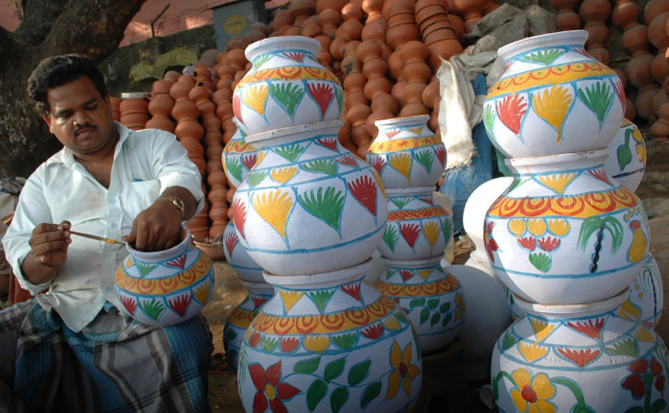 A claypot-vendor decorating his ware for the season. Firstpost