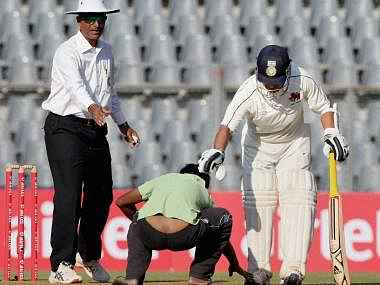 A spectator ran on to the ground after Tendulkar got his ton. PTI