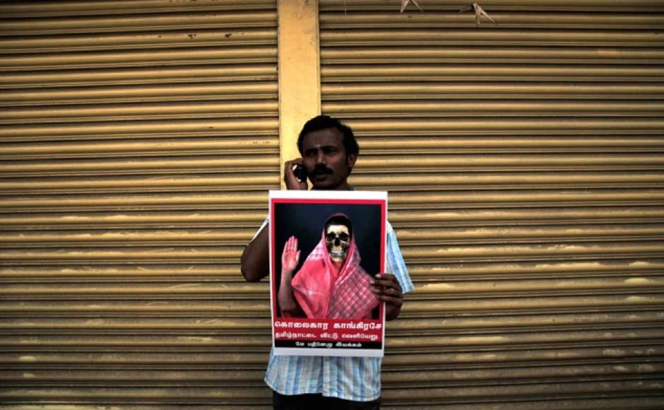 A participant in the protest rally in Chennai against the Congress for not taking action against the Sri Lankan government over alleged war crimes committed. Firstpost