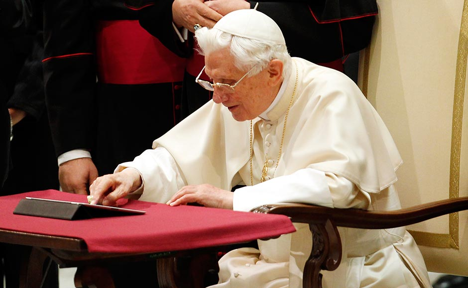 Pope Benedict XVI posts his first tweet using an iPad tablet after his Wednesday general audience in Paul VI's Hall at the Vatican on 12 December, 2012. Giampiero Sposito/Reuters