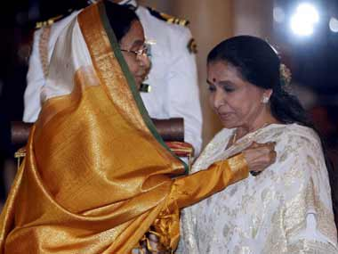 Bhosle receiving the Padma Vibhushan. AFP