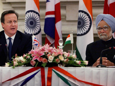 Prime Minister Manmohan Singh with his British counterpart David Cameron during a joint statement in Hyderabad House in New Delhi. PTI