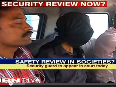 The accused (faced covered) when he was initially arrested by the police. Screengrab from IBNLive video.