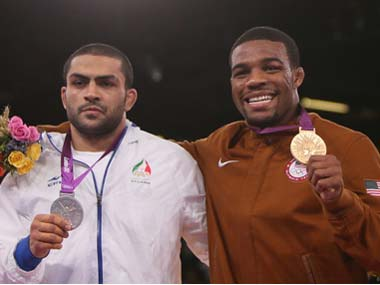Silver medallist Iran's Sadegh Saeed Goudarzi and gold medallist US' Jordan Ernest Burroughs at the 2012 Olympic Games. Getty