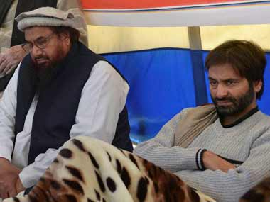 Hafiz Saeed with Yasin Malik. PTI.