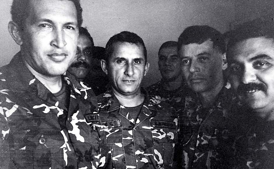 Venezuelan President Hugo Chavez (L) is shown in a 1992 file photo in jail after being arrested for a coup attempt. He stands next to Francisco Arias (2nd R), who is currently running for president, and former police chief Jesus Urdanetta (back center). File photo/Reuters