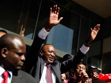 Kenyan president elect Uhuru Kenyatta waves at supporters after winning the elections in Nairobi. AP