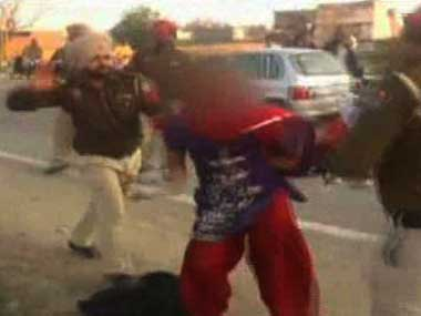 Screen grab from video in which Punjab police officials were seen beating up a woman.