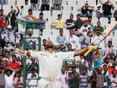 Shikhar Dhawan celebrates after reaching his hundred. PTI