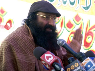 Syed Salahuddin, head of the militant Hizbul Mujahideen addresses the media during a public meeting to mark the Kashmir Solidarity Day in Muzaffarabad. AFP