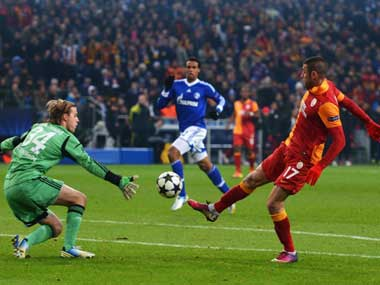 Burak Yilmaz scores in the Champions League. Getty Images