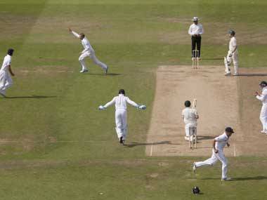 England's Joe Root, upper centre left,  celebrates after taking the wicket of Australia's Ed Cowan, lower centre right, caught by Jonathan Trott for 14 on the fourth day of the opening Ashes series cricket match at Trent Bridge cricket ground, Nottingham, England, Saturday. AP