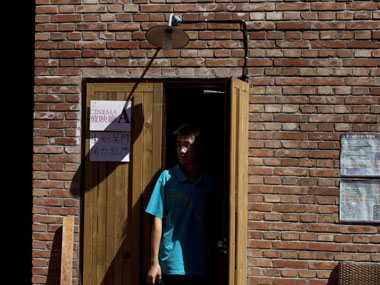 A man walks out of a cinema room where films are shown at the Beijing Independent Film Festival in Beijing, China. AP