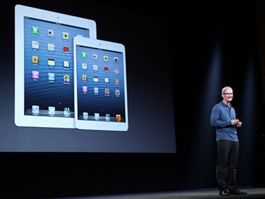 Apple CEO Tim Cook at the launch of the iPad 4th generation and the iPad mini. AFP