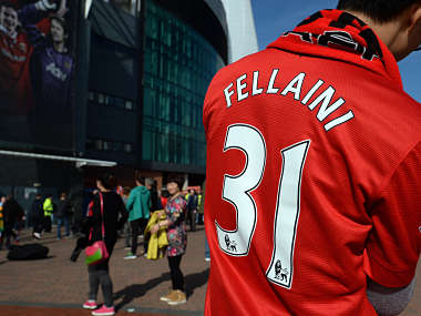 A Man Utd fan wearing a Fellaini shirt. Getty Images
