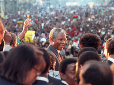 Nelson Mandela is all smiles as he is greeted by tens of thousands of people in Harlem, New York's famous black district, in this 1990 file photo. Reuters