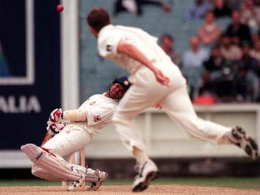 Sachin Tendulkar ducks under a Glenn McGrath folder. Getty Images