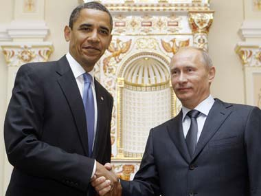 Barack Obama and Vladimir Putin. AP