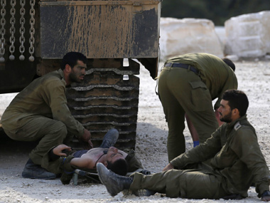 An Israeli soldier, wounded during Israel's offensive in Gaza, lies on a stretcher before being evacuated near the border with Gaza. Representational Image. Reuters Image