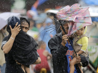 Slum residents of Baseco evacuate to safer grounds as Typhoon Rammasun hit Philippines in July 2014. AP