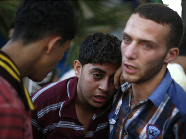 Relatives of Palestinians killed in an Israeli air strike grieve at a hospital in Gaza City. Reuters image