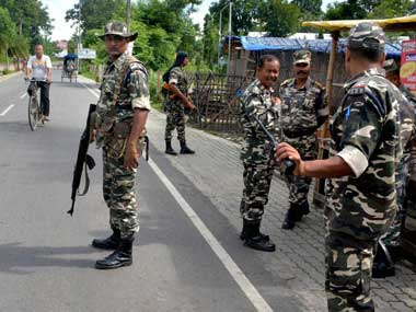 Security personnel patrol in the streets of tension-gripped Golaghat town after curfew was extended till 6PM on Friday. PTI
