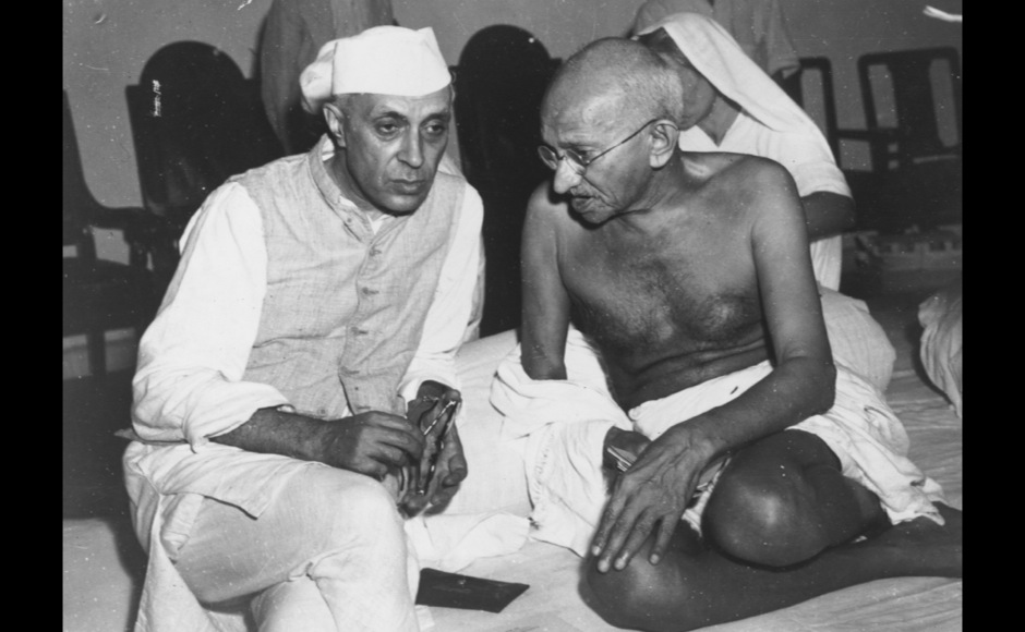<p> Mahatma Gandhi and Pandit Nehru chat at the All-India Congress committee meeting at Bombay. Getty Images</p>