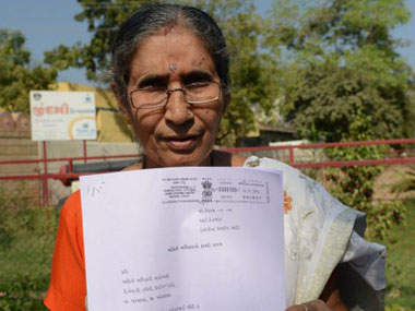 Jashodaben with a copy of the RTI. AFP.
