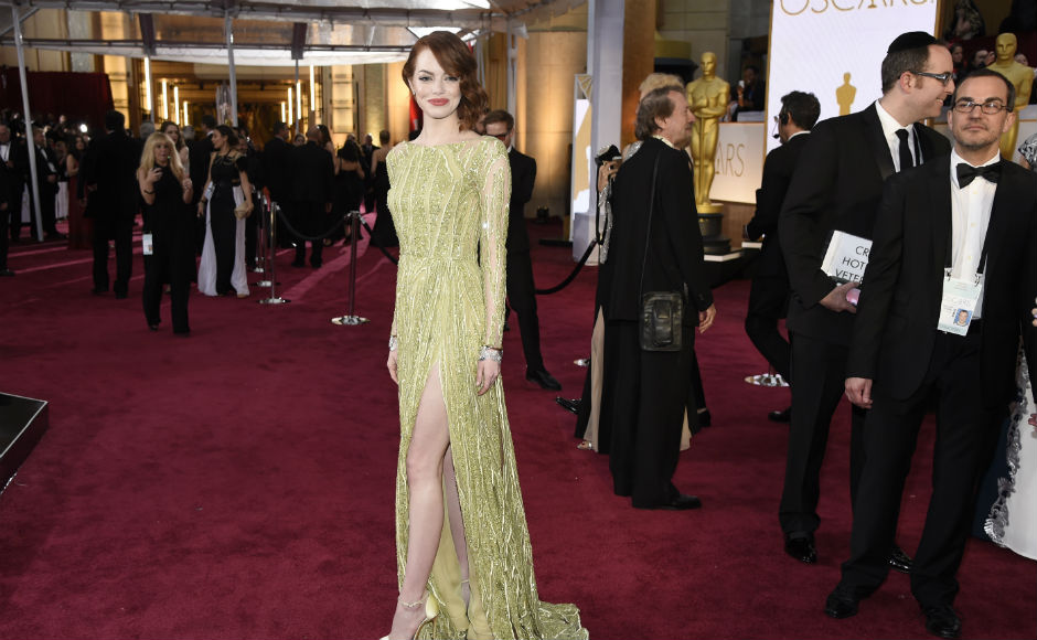 Emma Stone in a stunning green Elie Saab gown. Associated Press