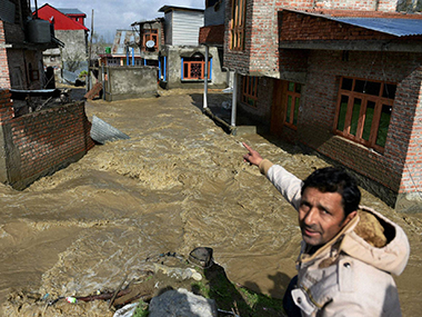 Flood water enters Hamdania Colony Bemina in Srinagar. PTI Photo