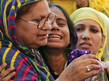 Relatives of Mohammad Akhlaq mourn his death. Reuters