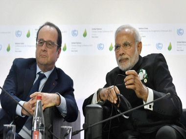 Prime Minister Narendra Modi with French President Francois Hollande during the International Solar Alliance in Paris. PTI