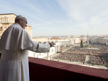 "Pope Francis delivers his ""Urbi et Orbi"" (to the city and to the world) blessing from the central balcony of St. Peter's Basilica at the Vatican. AP"