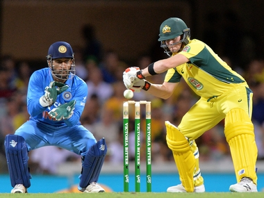 India captain MS Dhoni and Australia captain Steve Smith in action during the 2nd ODI at Brisbane. Getty