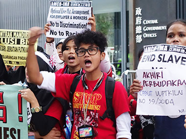 Rights workers protest in Hong Kong. Image Courtesy: DPA