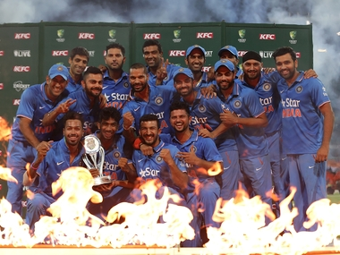 The Indian team poses with the trophy after T20I series win over Australia. Getty