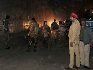 Security personnel at the site of the attack in Pathankot. PTI