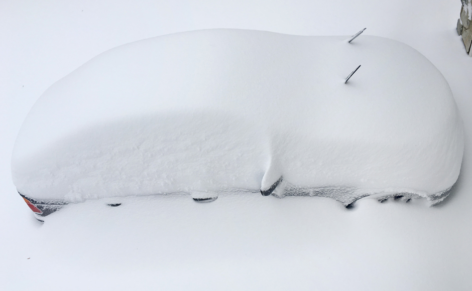 A car is seen buried in snow after an overnight snowstorm inside Washington DC Beltway in the United States. Reuters