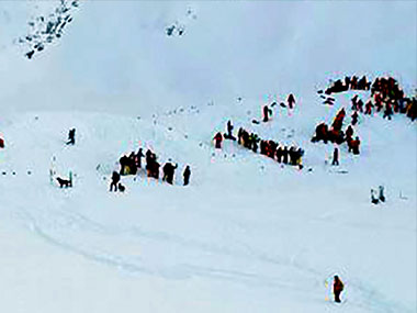 Rescuing teams gather for search and rescue operations on a piste at the avalanche site . AFP