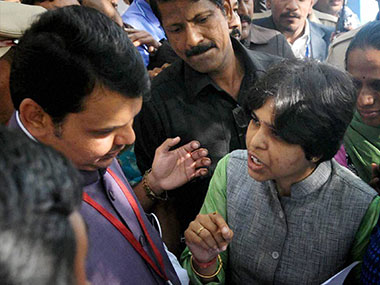 Activist Trupti Desai (right) speaks to Maharashtra CM Devendra Fadnavis. PTI