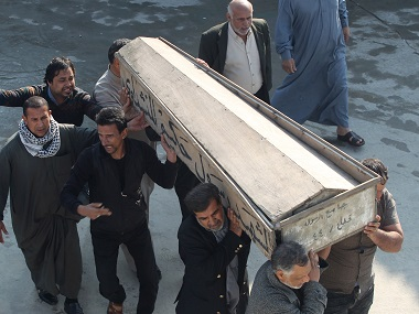 Mourners carry the coffin of their relative, who was killed in bomb attack in Baghdad, during the funeral in Najaf. Reuters